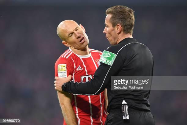 Arjen Robben of Bayern Muenchen and referee Tobias Stieler talk during the Bundesliga match between FC Bayern Muenchen and FC Schalke 04 at Allianz...