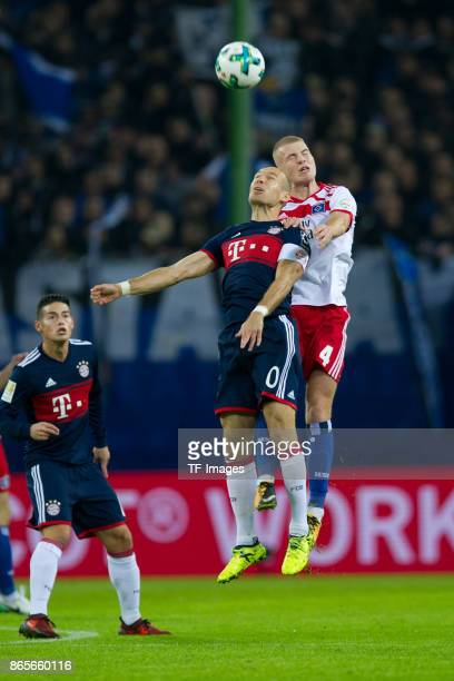 Arjen Robben of Bayern Muenchen and Rick van Drongelen of Hamburg battle for the ball during the Bundesliga match between Hamburger SV and FC Bayern...