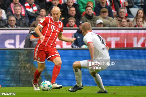 Arjen Robben of Bayern Muenchen and Rick van Drongelen of Hamburg battle for the ball during the Bundesliga match between FC Bayern Muenchen and...
