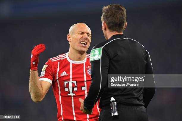 Arjen Robben of Bayern Muenchen argues with referee Tobias Stieler during the Bundesliga match between FC Bayern Muenchen and FC Schalke 04 at...