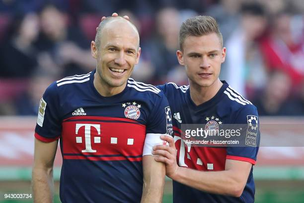 Arjen Robben of Bayern Muenchen celebrates after he scored a goal to make it 13 with Joshua Kimmich of Bayern Muenchen during the Bundesliga match...