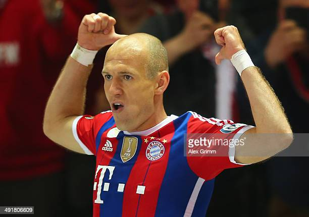 Arjen Robben of Bayern Muenchen celebrates after scoring his team's first goal during the DFB Cup Final match between Borussia Dortmund and FC Bayern...
