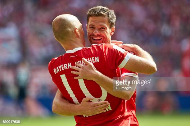 Arjen Robben of Bayern Muenchen celebrates after scoring his team`s first goal during the Bundesliga match between Bayern Muenchen and SC Freiburg at...