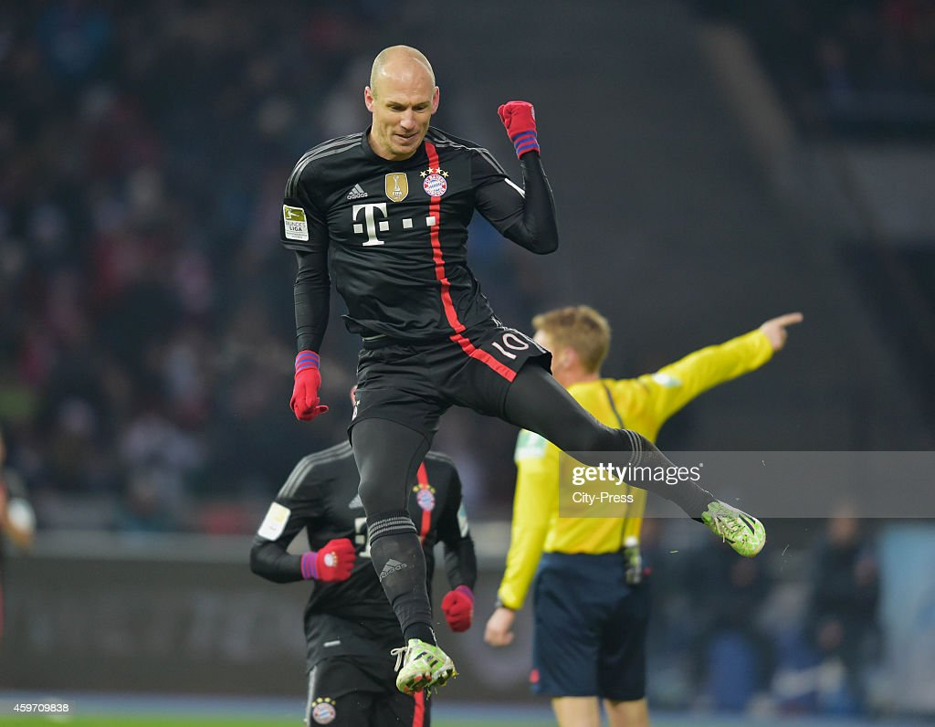 Arjen Robben of Bayern Muenchen celebrates after scoring the opening goal during the Bundesliga match between Hertha BSC and Bayern Muenchen at Olympiastadion on November 29, 2014 in Berlin, Germany.