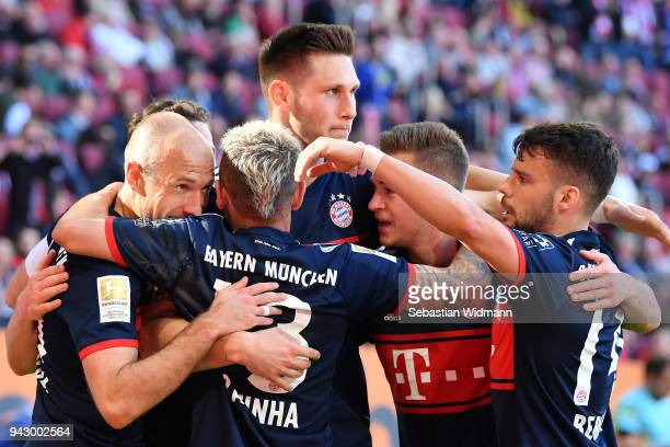 Arjen Robben of Bayern Muenchen celebrates scoring his teams third goal with his teammates during the Bundesliga match between FC Augsburg and FC...