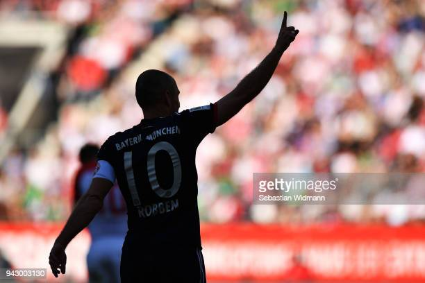 Arjen Robben of Bayern Muenchen celebrates scoring his teams third goal during the Bundesliga match between FC Augsburg and FC Bayern Muenchen at...