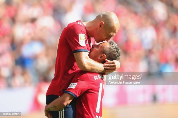 Arjen Robben of Bayern Muenchen celebrates scoring the second team goal with his team mate Rafinha during the Bundesliga match between FC Bayern...