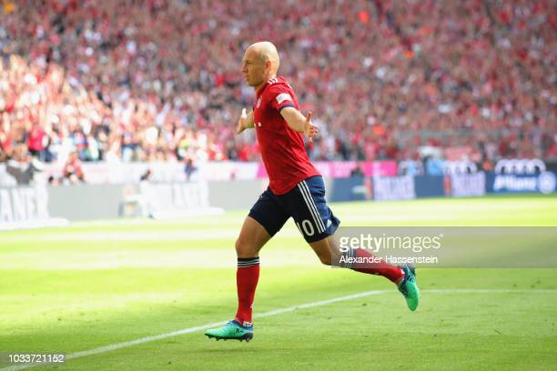 Arjen Robben of Bayern Muenchen celebrates scoring the second team goal during the Bundesliga match between FC Bayern Muenchen and Bayer 04...