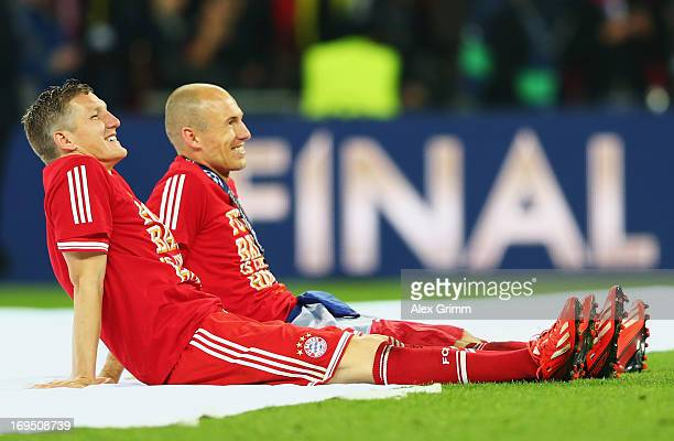 Arjen Robben of Bayern Muenchen celebrates victory with team mate Bastian Schweinsteiger after the UEFA Champions League final match between Borussia...