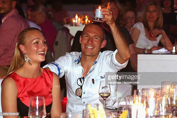 Arjen Robben of Bayern Muenchen celebrates with his wife Bernadien Robben during the official Champions party at Postpalast on May 10 2014 in Munich...