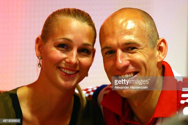Arjen Robben of Bayern Muenchen celebrates with his wife Bernadien during the FC Bayern Muenchen Champions party after winning the German DFB Cup...