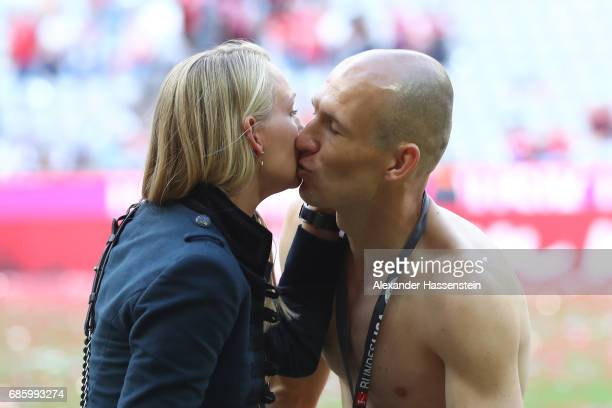 Arjen Robben of Bayern Muenchen celebrates with his wife Bernadien Robben following the Bundesliga match between Bayern Muenchen and SC Freiburg at...
