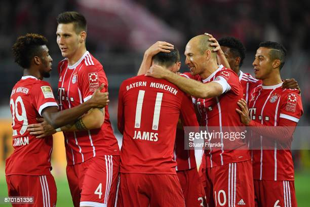 Arjen Robben of Bayern Muenchen celebrates with James Rodriguez of Bayern Muenchen and other players after he scored a goal to make it 01 during the...