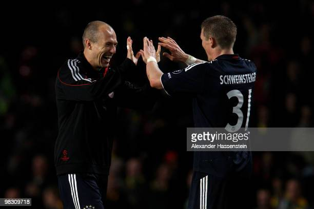 Arjen Robben of Bayern Muenchen celebrates with team mate Bastian Schweinsteiger at the end of the UEFA Champions League Quarter Final second leg...