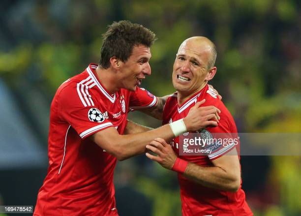 Arjen Robben of Bayern Muenchen celebrates with teammate Mario Mandzukic after winning the UEFA Champions League Final against Borussia Dortmund at...