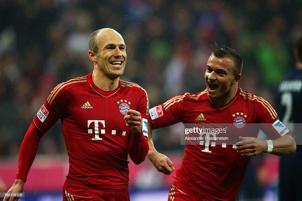 Arjen Robben (L)of Bayern Muenchen celebrates with teammate Xherdan Shaqiri after scoring his team's fourth goal during the Bundesliga match between FC Bayern Muenchen and Hamburger SV at Allianz Arena on March 30, 2013 in Munich, Germany.
