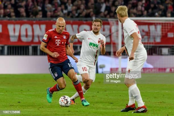 Arjen Robben of Bayern Muenchen Daniel Baier of FC Augsburg and Martin Hinteregger of FC Augsburg battle for the ball during the Bundesliga match...