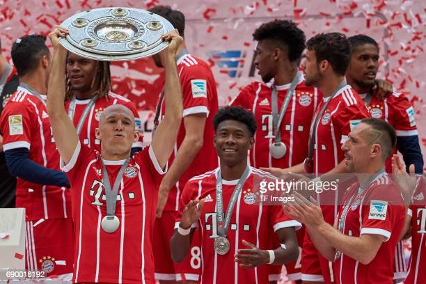 Arjen Robben of Bayern Muenchen , David Alaba of Bayern Muenchen and Franck Ribery of Bayern Muenchen poses with the Championship trophy in...