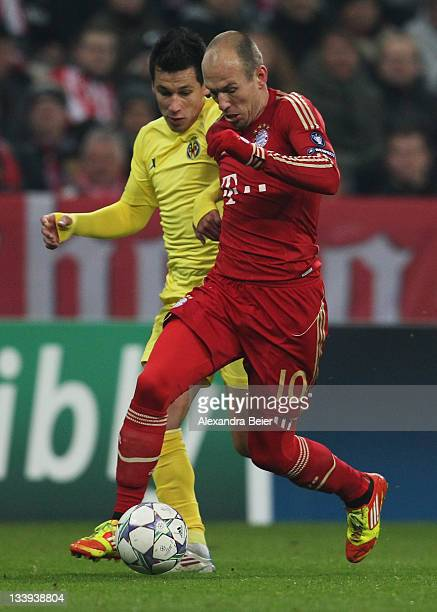 Arjen Robben of Bayern Muenchen fights for the ball Hernan Perez of Villareal during the UEFA Champions League group A match between FC Bayern...