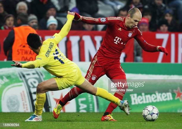 Arjen Robben of Bayern Muenchen fights for the ball with Hernan Perez of Villareal during the UEFA Champions League group A match between FC Bayern...