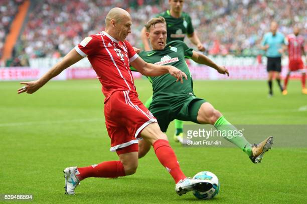 Arjen Robben of Bayern Muenchen fights for the ball with Ludwig Augustinsson of Bremen during the Bundesliga match between SV Werder Bremen and FC...