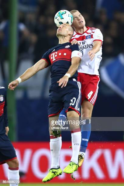 Arjen Robben of Bayern Muenchen fights for the ball with Rick van Drongelen of Hamburg during the Bundesliga match between Hamburger SV and FC Bayern...