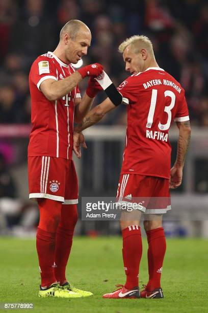 Arjen Robben of Bayern Muenchen goes off and gives the captains band to Rafinha of Bayern Muenchen during the Bundesliga match between FC Bayern...