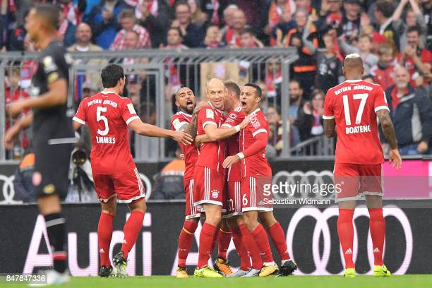 Arjen Robben of Bayern Muenchen is celebrated by his team mates after he scored his teams second goal to make it 20 during the Bundesliga match...