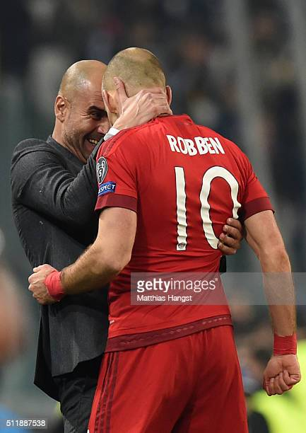 Arjen Robben of Bayern Muenchen is congratulated by Josep Guardiola the head coach of Bayern Muenchen after scoring his team's second goal during the...
