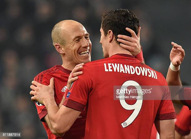Arjen Robben of Bayern Muenchen is congratulated by teammate Robert Lewandowski of Bayern Muenchen after scoring his team's second goal during the...