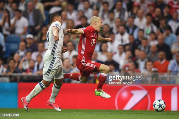 Arjen Robben of Bayern Muenchen is fouled by Casemiro of Real Madrid and a penalty is awarded during the UEFA Champions League Quarter Final second...