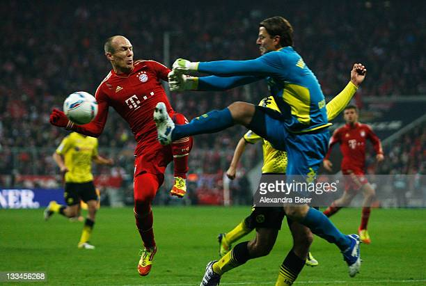 Arjen Robben of Bayern Muenchen jumps for the ball with goalkeeper Roman Weidenfeller of Dortmund during the Bundesliga match between FC Bayern...