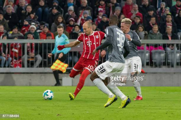 Arjen Robben of Bayern Muenchen Kevin Danso of Augsburg Philipp Max of Augsburg battle for the ball during the Bundesliga match between FC Bayern...