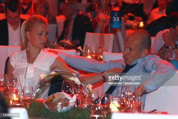 Arjen Robben of Bayern Muenchen looks on with his wife Bernadien Robben during the FC Bayern Muenchen after party at Postpalast on May 20 2012 in...