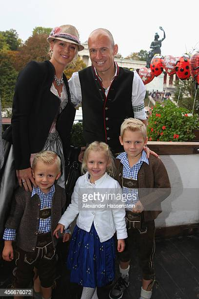 Arjen Robben of Bayern Muenchen poses with his wife Bernadien Robben in front of the ensemble of the Bavaria statue a monumental bronze sandcast...
