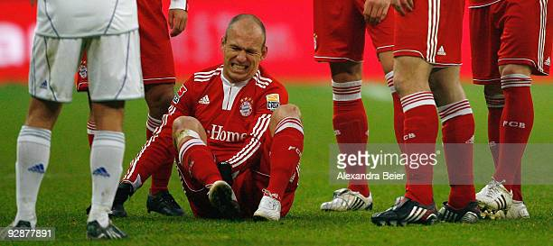 Arjen Robben of Bayern Muenchen reacts after he was fouled during the German Bundesliga football match against Schalke 04 at Allianz Arena on...
