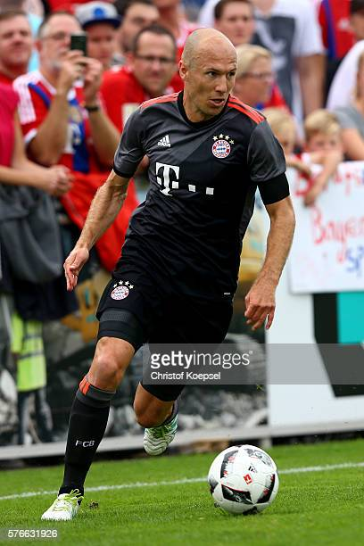 Arjen Robben of Bayern Muenchen runs with the ball during the friendly match between SV Lippstadt and FC Bayern at Stadion am Bruchbaum on July 16...
