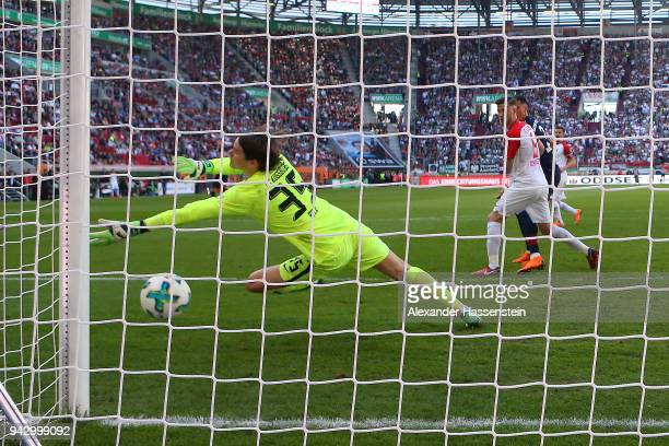 Arjen Robben of Bayern Muenchen scores a goal to make it 13 past goalkeeper Marwin Hitz of Augsburg during the Bundesliga match between FC Augsburg...