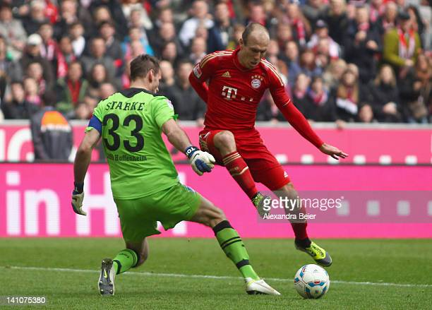 Arjen Robben of Bayern Muenchen scores against goalkeeper Tom Starke of Hoffenheim during the Bundesliga match between FC Bayern Muenchen and 1899...