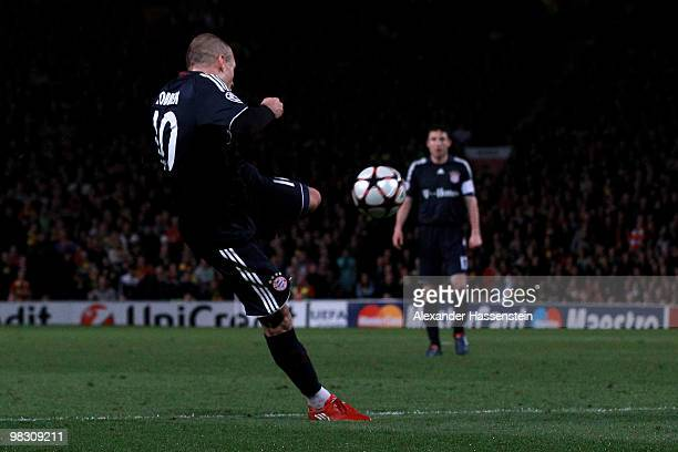 Arjen Robben of Bayern Muenchen scores his team's second goal during the UEFA Champions League Quarter Final second leg match between Manchester...