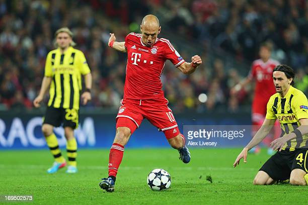 Arjen Robben of Bayern Muenchen scores their second goal during the UEFA Champions League final match between Borussia Dortmund and FC Bayern...