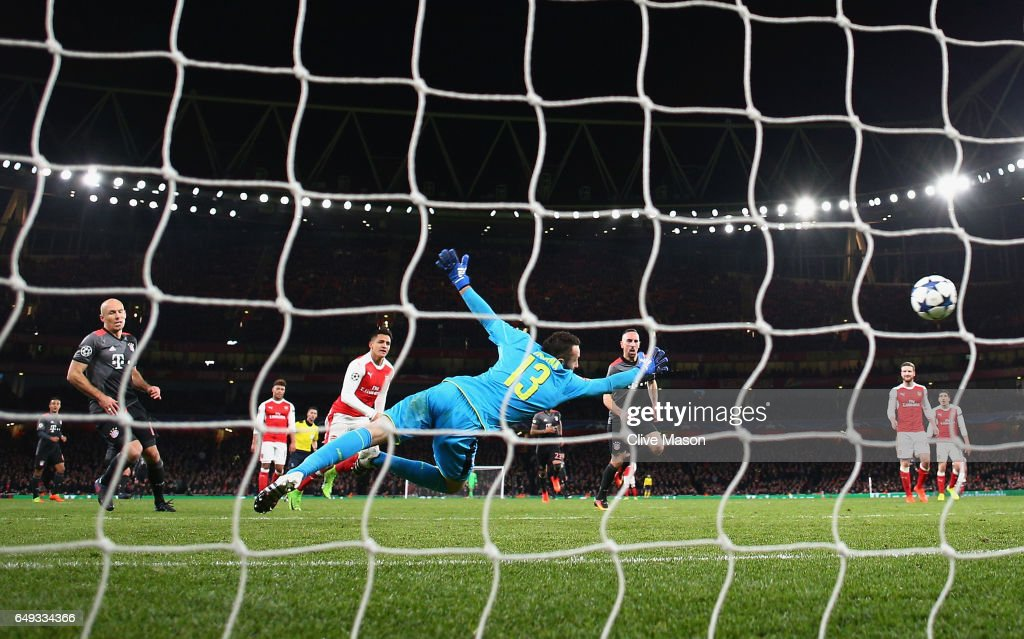 Arjen Robben of Bayern Muenchen (L) scores their second goal past goalkeeper David Ospina of Arsenal during the UEFA Champions League Round of 16 second leg match between Arsenal FC and FC Bayern Muenchen at Emirates Stadium on March 7, 2017 in London, United Kingdom.