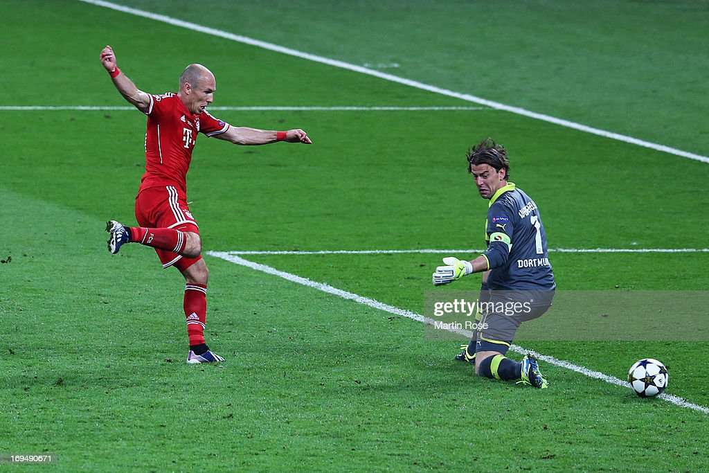 Arjen Robben of Bayern Muenchen scores their second goal past Roman Weidenfeller of Borussia Dortmund during the UEFA Champions League final match between Borussia Dortmund and FC Bayern Muenchen at Wembley Stadium on May 25, 2013 in London, United Kingdom.
