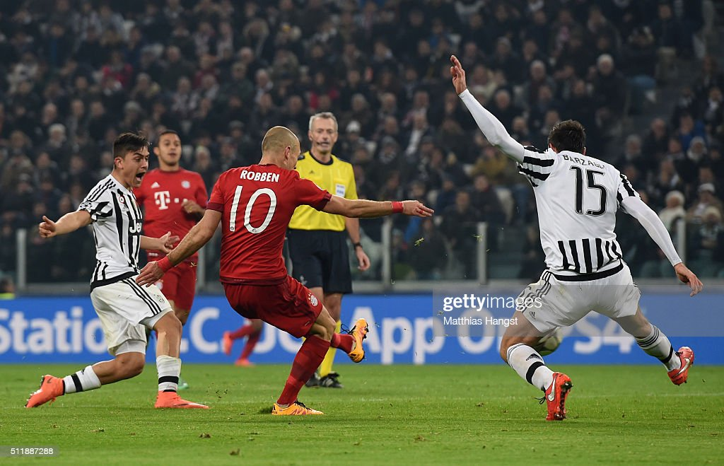 Arjen Robben of Bayern Muenchen shoots past Andrea Barzagli of Juventus to score his team's second goal during the UEFA Champions League round of 16, first leg match between Juventus and FC Bayern Muenchen at Juventus Arena on February 23, 2016 in Turin, Italy.