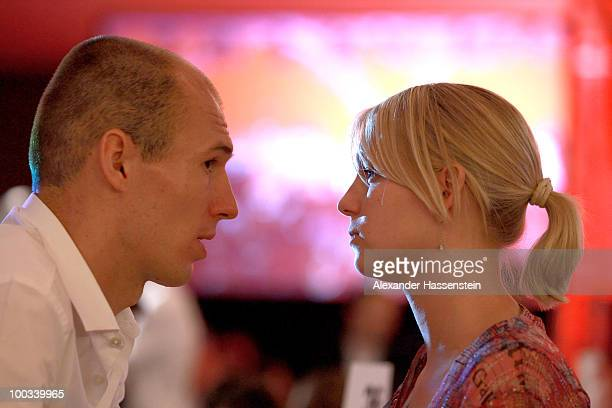 Arjen Robben of Bayern Muenchen smiles with his wife Bernadien during the Champions League banquet after the UEFA Champions League Final match...