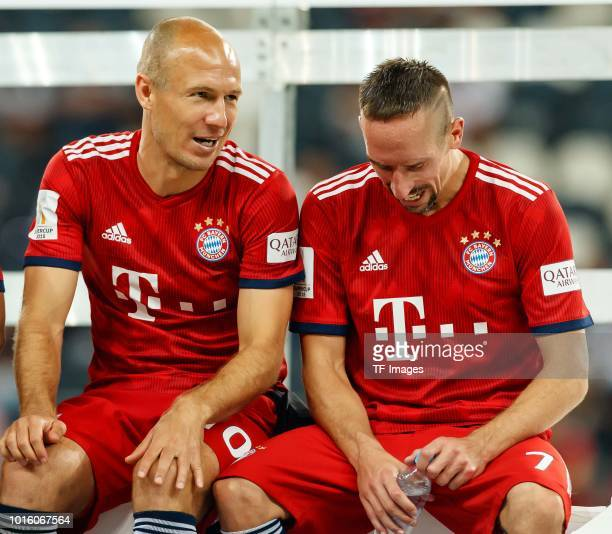 Arjen Robben of Bayern Muenchen speaks with Franck Ribery of Bayern Muenchen prior to the DFL Supercup match between Eintracht Frankfurt and Bayern...