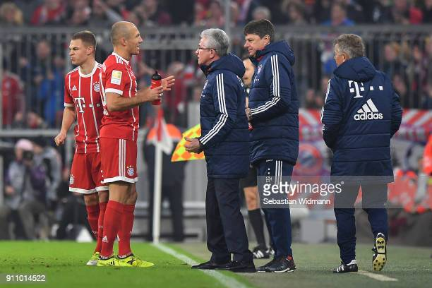 Arjen Robben of Bayern Muenchen talks to Jupp Heynckes head coach of Bayern Muechen during the Bundesliga match between FC Bayern Muenchen and TSG...