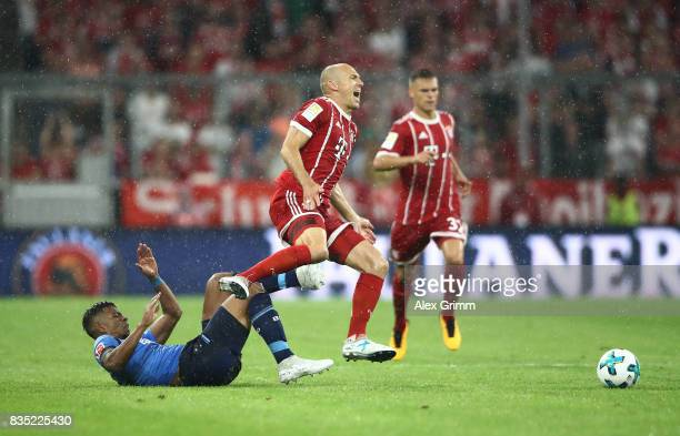 Arjen Robben of Bayern Muenchen with Benjamin Henrichs of Bayer Leverkusen during the Bundesliga match between FC Bayern Muenchen and Bayer 04...