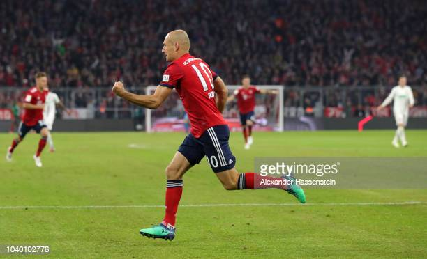Arjen Robben of Bayern Munich celebrates after scoring his team's first goal during the Bundesliga match between FC Bayern Muenchen and FC Augsburg...