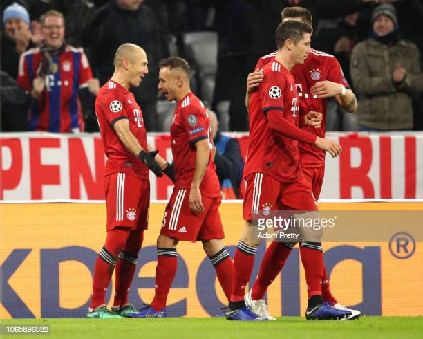 Arjen Robben of Bayern Munich celebrates after scoring his team's first goal with team mate Rafinha during the UEFA Champions League Group E match...